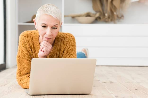 elderly woman thinking looking laptop 23 2148419268